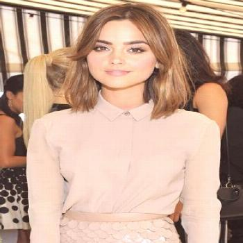 Jenna Coleman kept things relatively monochromatic in a nude shirt and a sequin scallop pencil skir